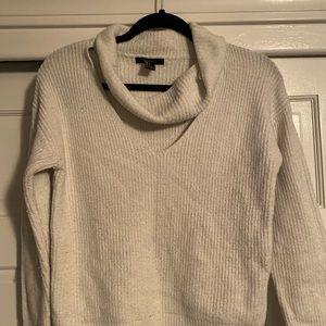 Sweater with cut out neck piece